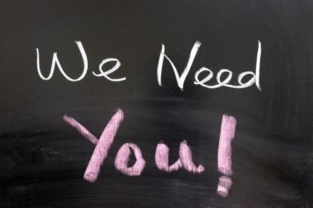 We Need You written on chalkboard
