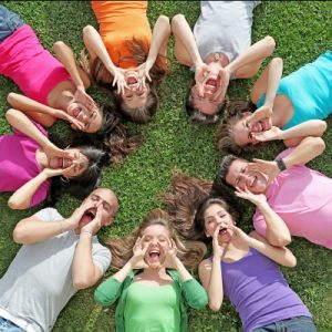 Yearbook - Kids laying on the ground in a circle