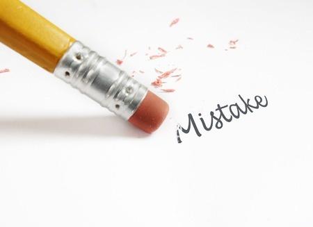 closeup of a pencil eraser fixing an mistake